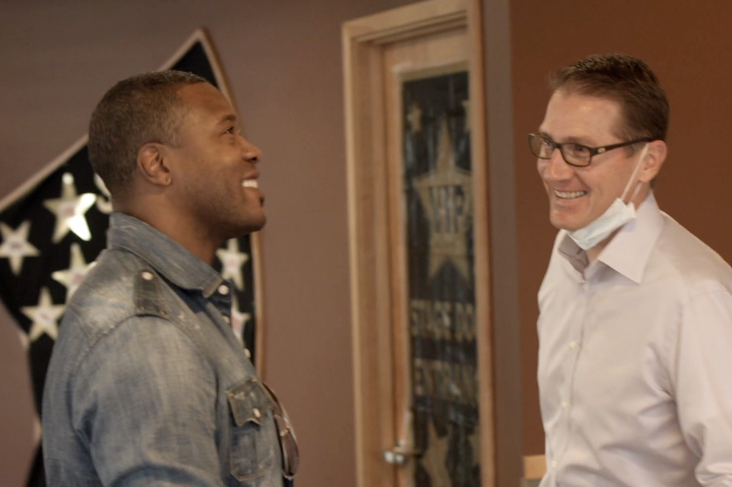 Bryan Roos laughing with Lawyer Milloy